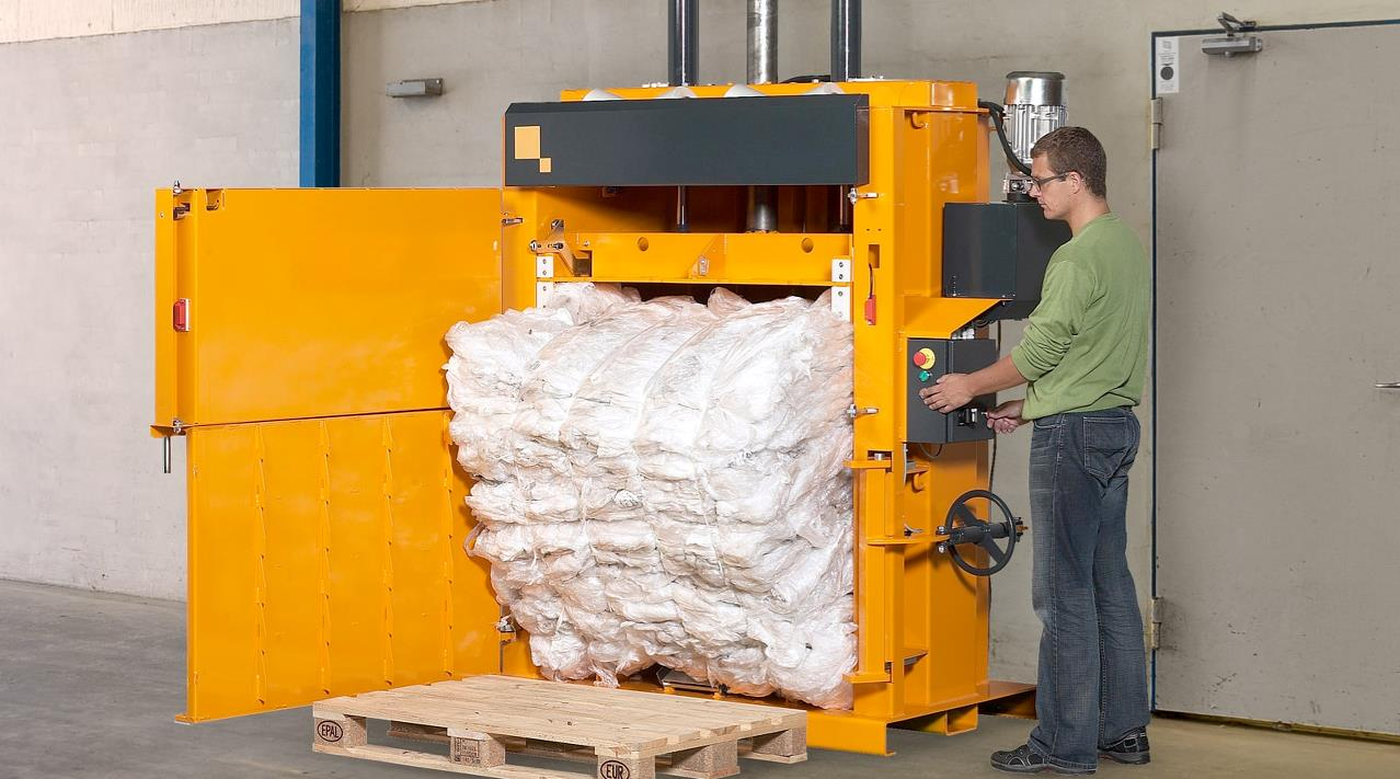 Employee ejects huge plastic bale from Bramidan baler