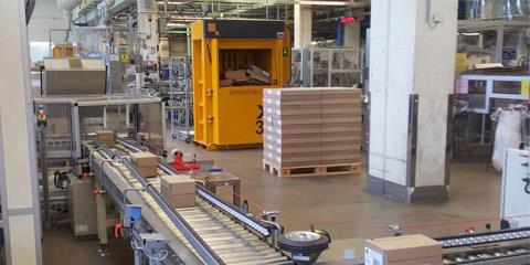 Factory Cosmeva with Bramidan baler next to assembly line