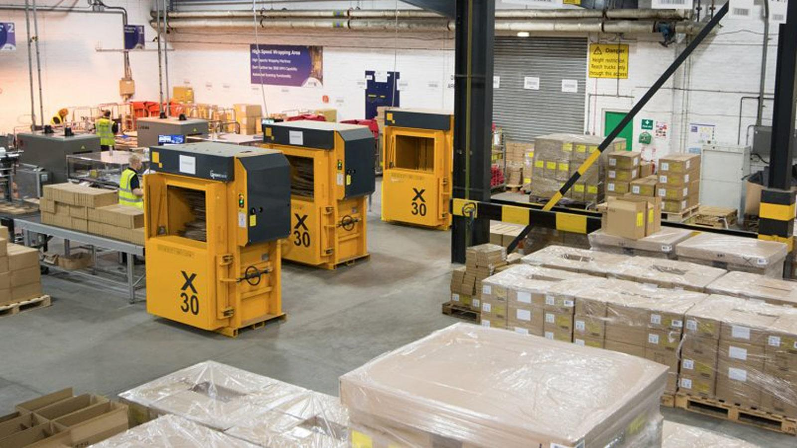 Production hall with 3 yellow Bramidan balers X30