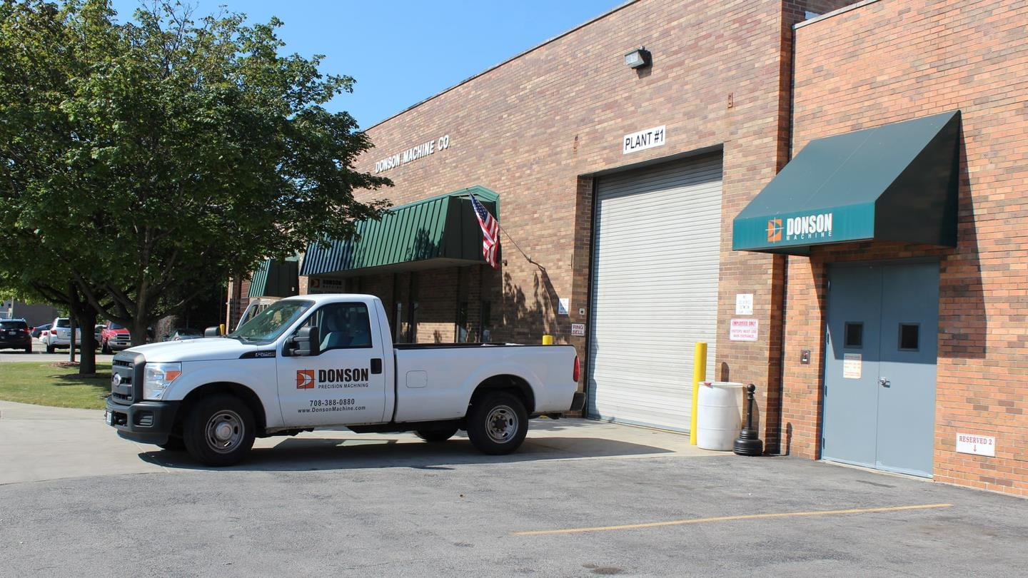 White van in front of warehouse at Chicago company Donson Machine