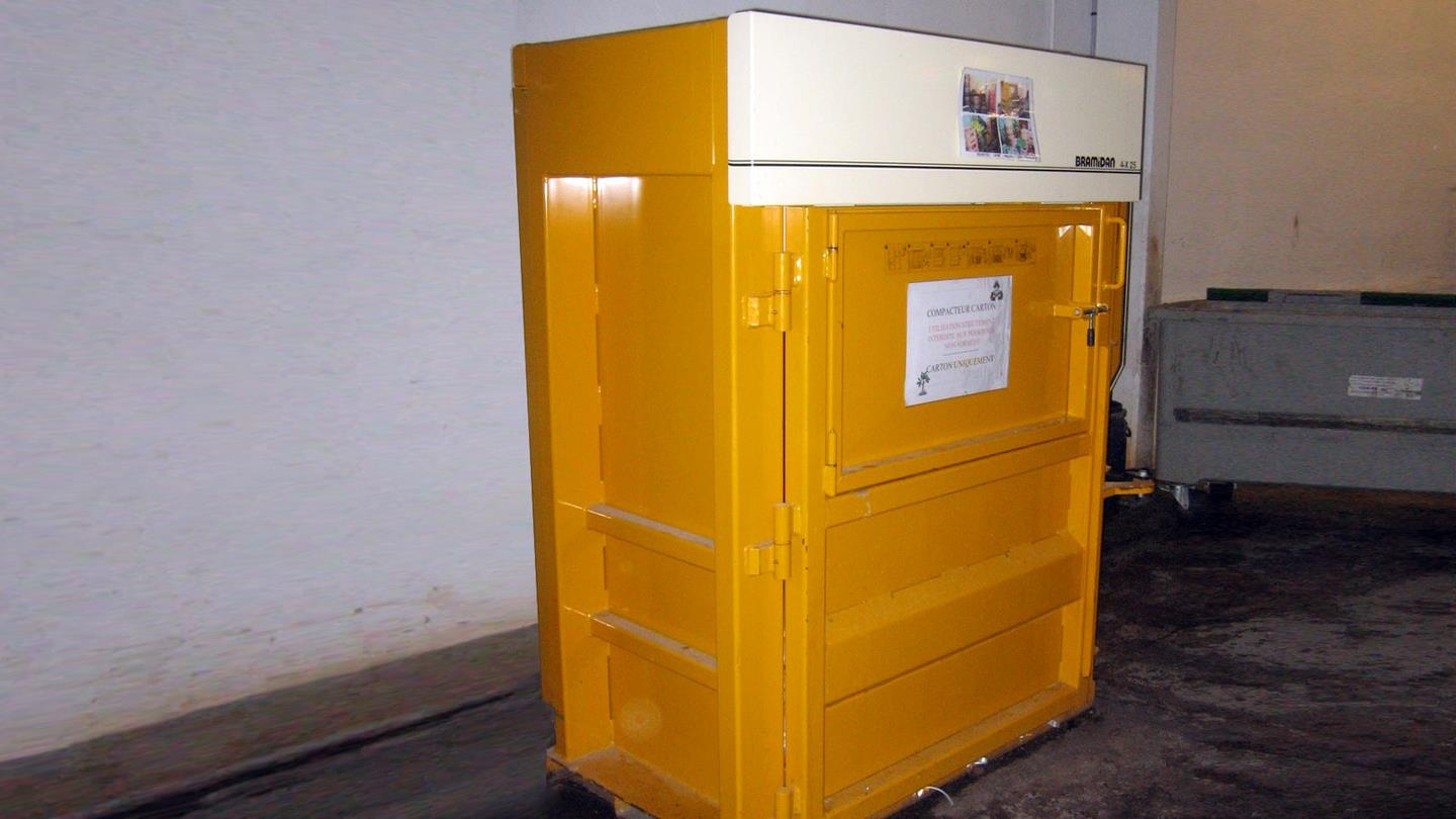 Yellow Bramidan baler in basement