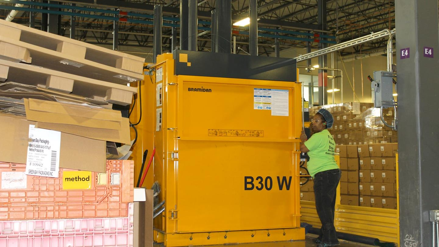 Employee from Method Home operates B30 Wide Bramidan baler