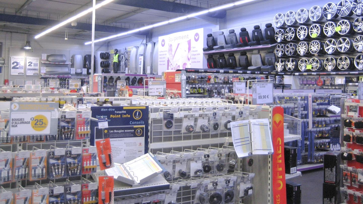 Spare parts and equipment on display for cars in Norauto shop