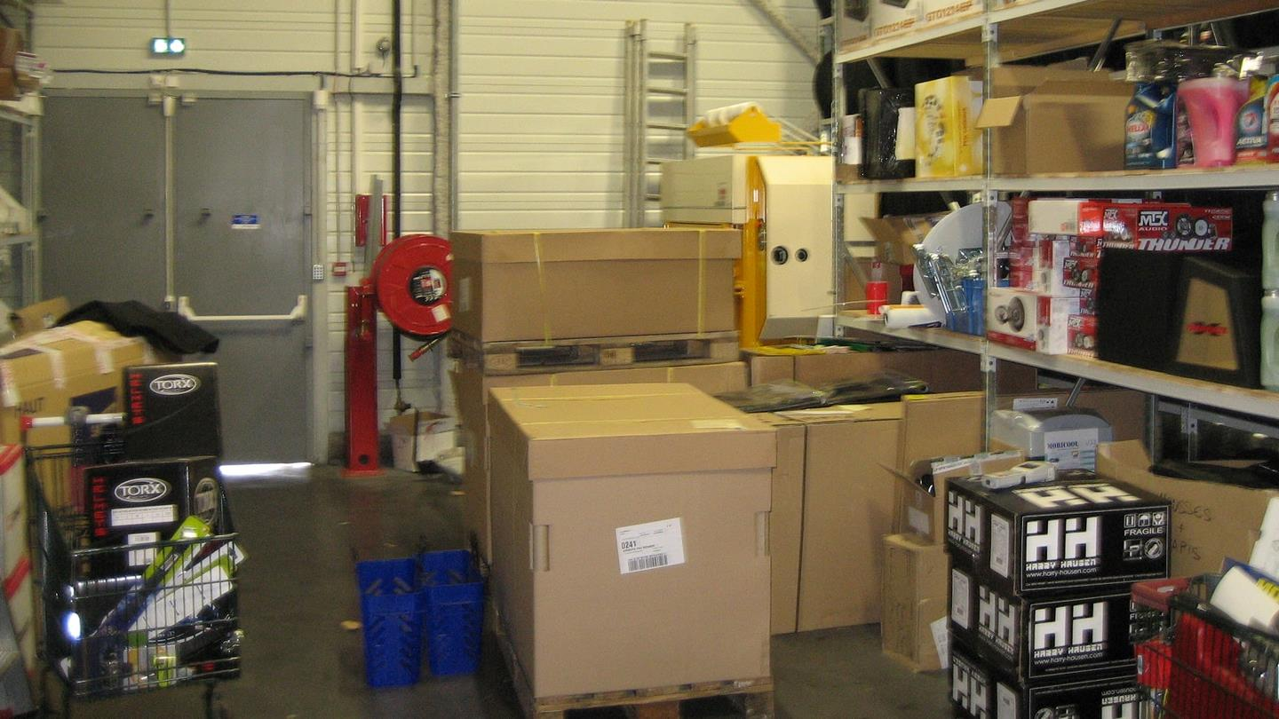 Cardboard boxes with spare parts for cars at Norauto warehouse