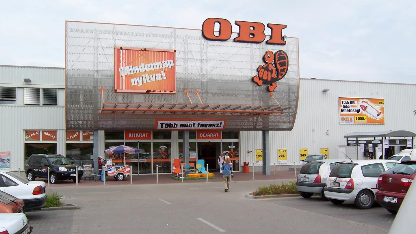 Entrance to OBI DIY store with logo and beaver symbol