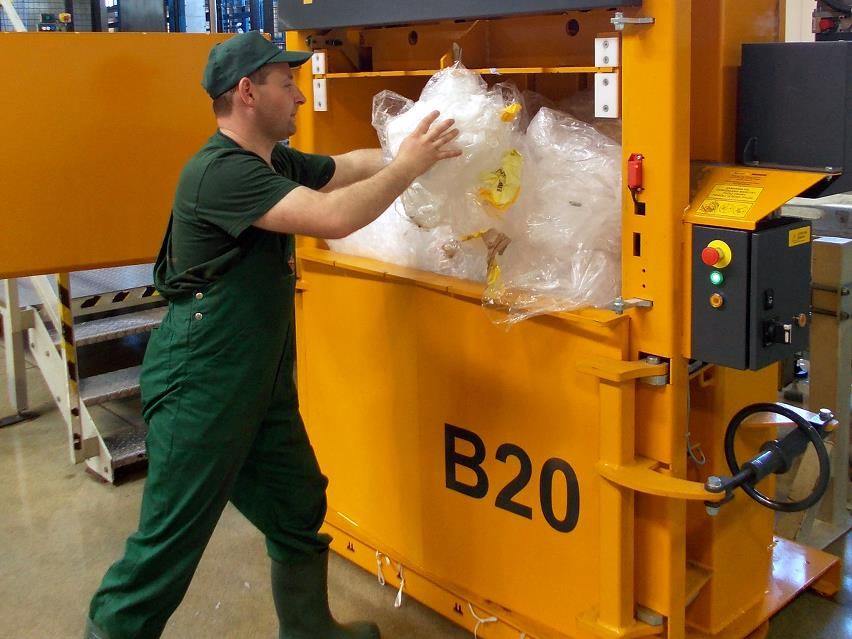 Man throws plastic waste into B20 baler from Bramidan