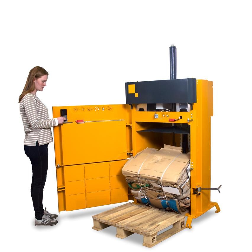 Girl ejects cardboard bale from small footprint baler B4 automatically