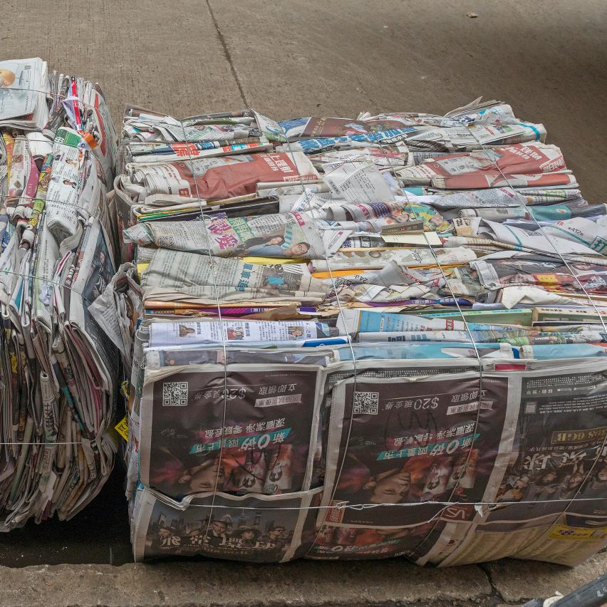 Newspaper for recycling compacted in a baler