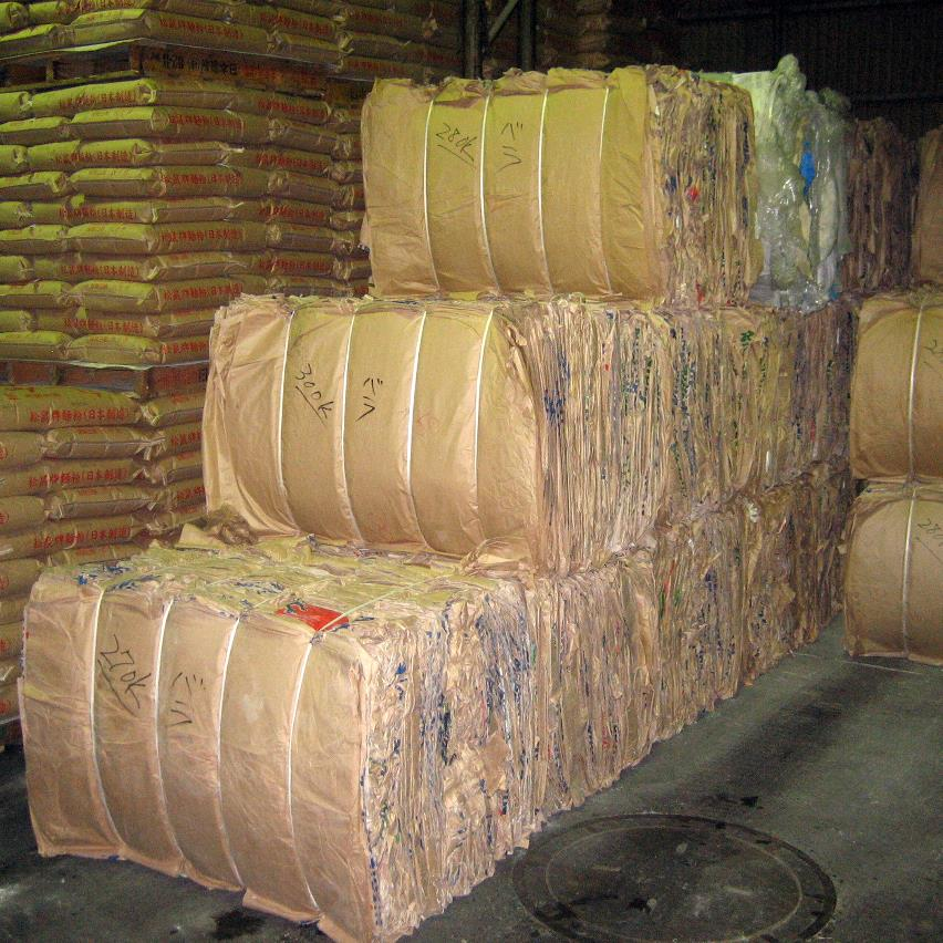 Bales with compacted paper sacs stacked in the warehouse
