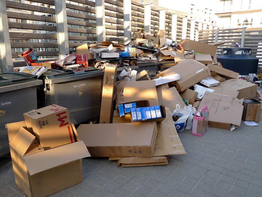 Cardboard waste and dumpsters in back area