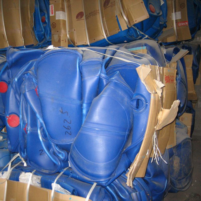 Bale of compacted plastic drums of HDPE plastic