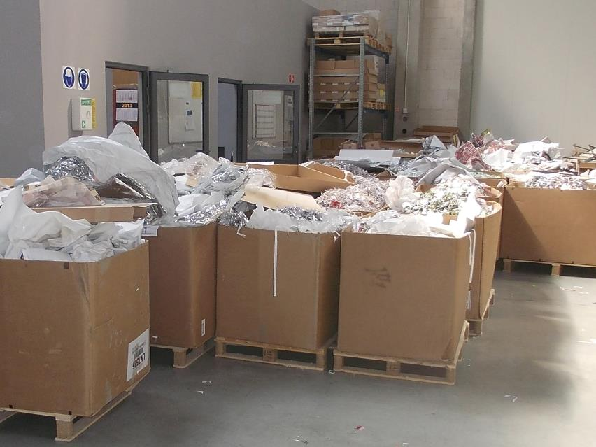 Paper waste collected in huge cardboard boxes at Illochroma