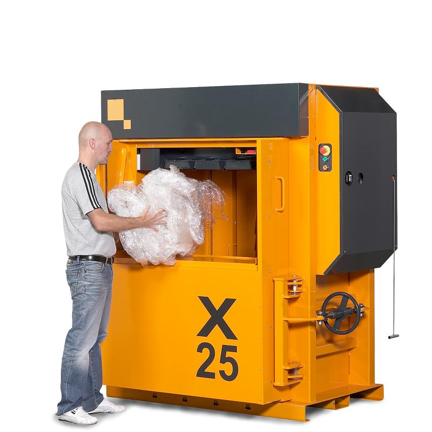 Man fills plastic waste into Baler X25 HD from Bramidan