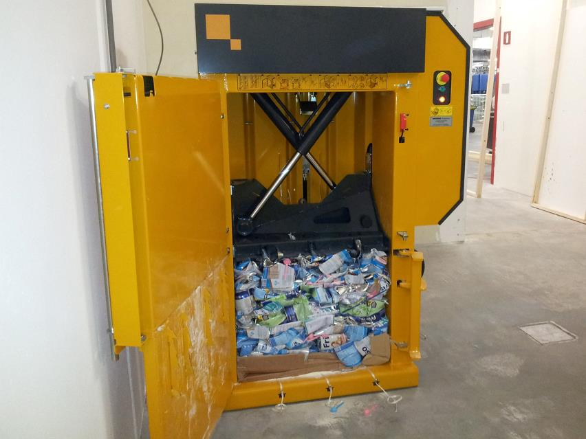 Small Bramidan baler with compacted alu cans inside chamber