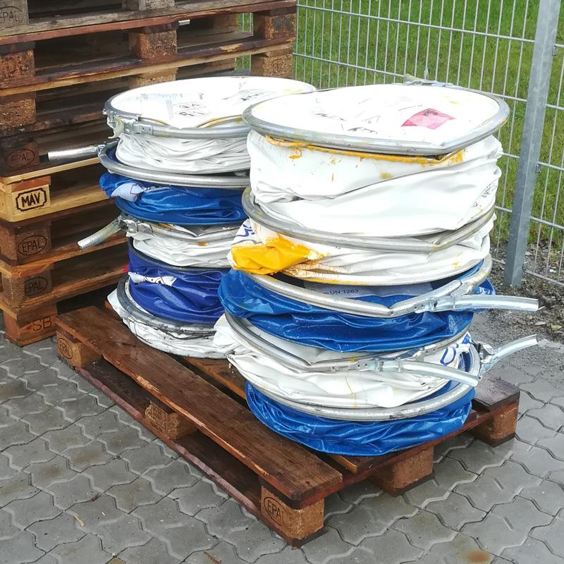 Compacted oil drums placed on pallet