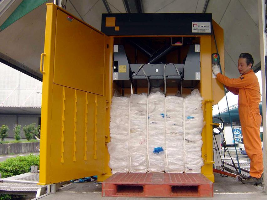 Plastic bale ready for ejection from Bramidan baler