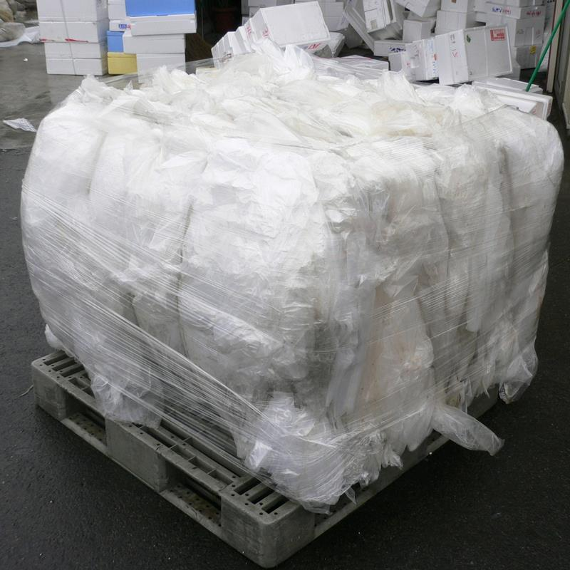 Bale of compacted soft plastic placed on pallet