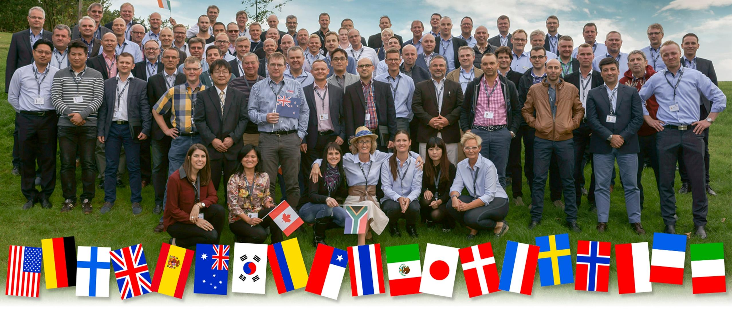 Bramidan Family picture with worldwide distributors and their flags