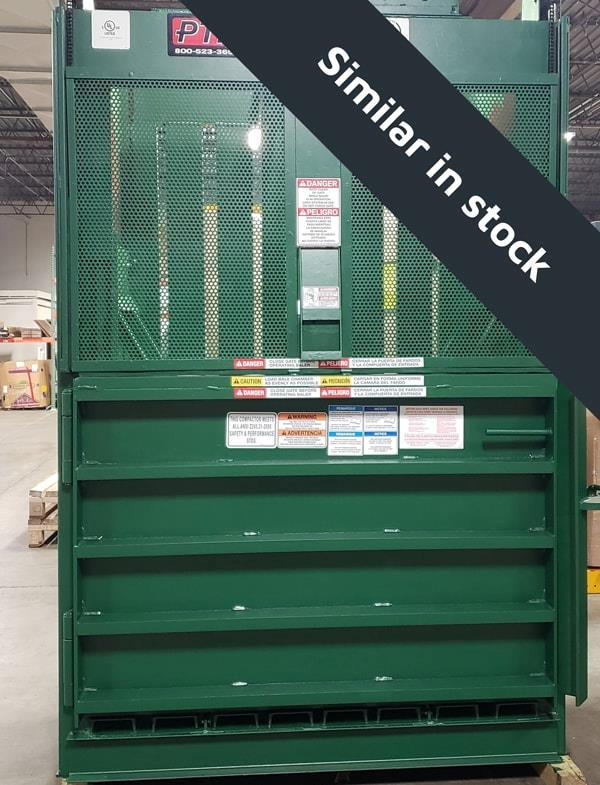 Green baler with white stickers and closed door